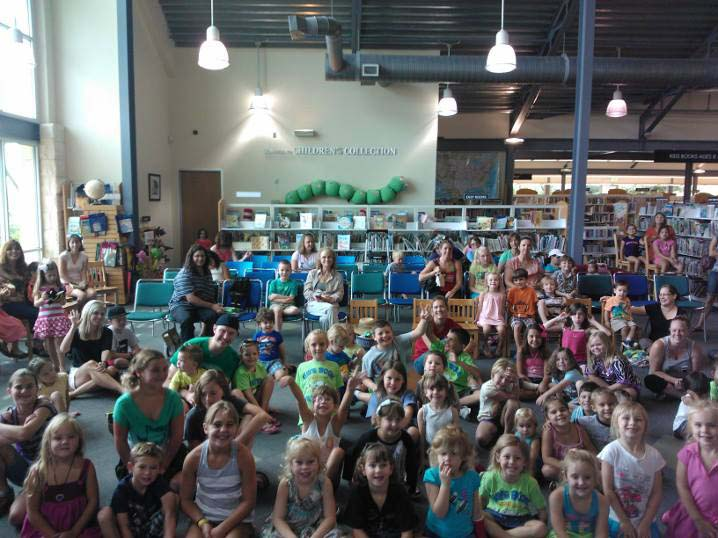 David Pitts, aka The Astonishing Mr. Pitts entertains a family audience at a Library Show in Bulverde, TX in 2013