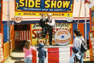 Ventriloquist David Pitts and his puppet friend Henry Little at the Big Circus Sideshow in Austin, Texas