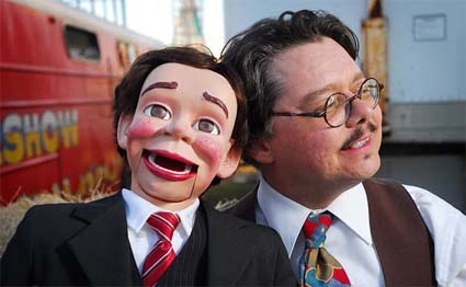 David Pitts, also known as The Astonishing Mr. Pitts, San Antonio, Texas magician and ventriloquist, and his wooden friend Henry Little in the 'backyard' of the Big Circus Sideshow