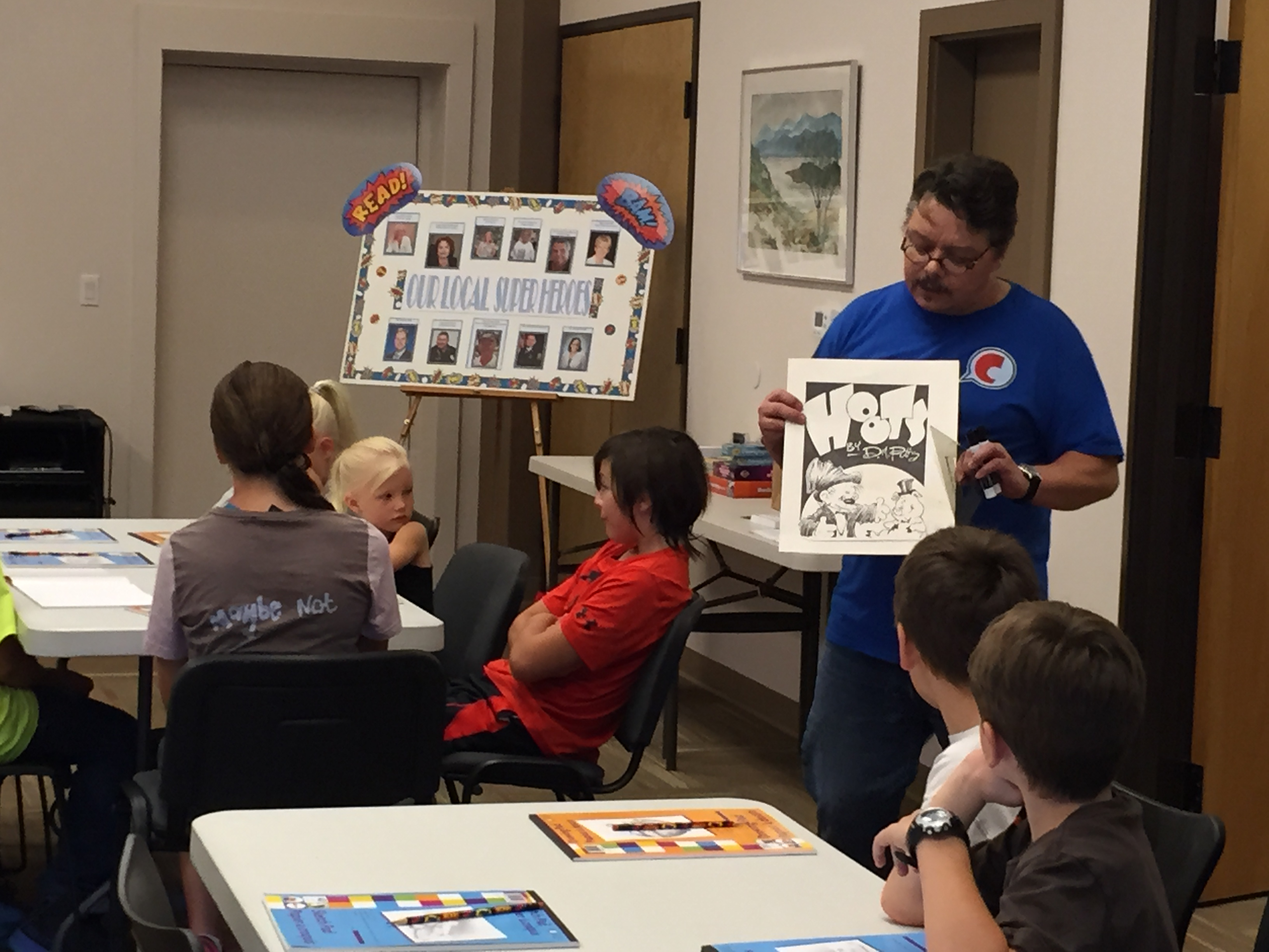 Cartoonist and comedian David Pitts teaches a Cartoon Class hands-on cartooning workshop to a group of children at the Lago Vista Tx. Library