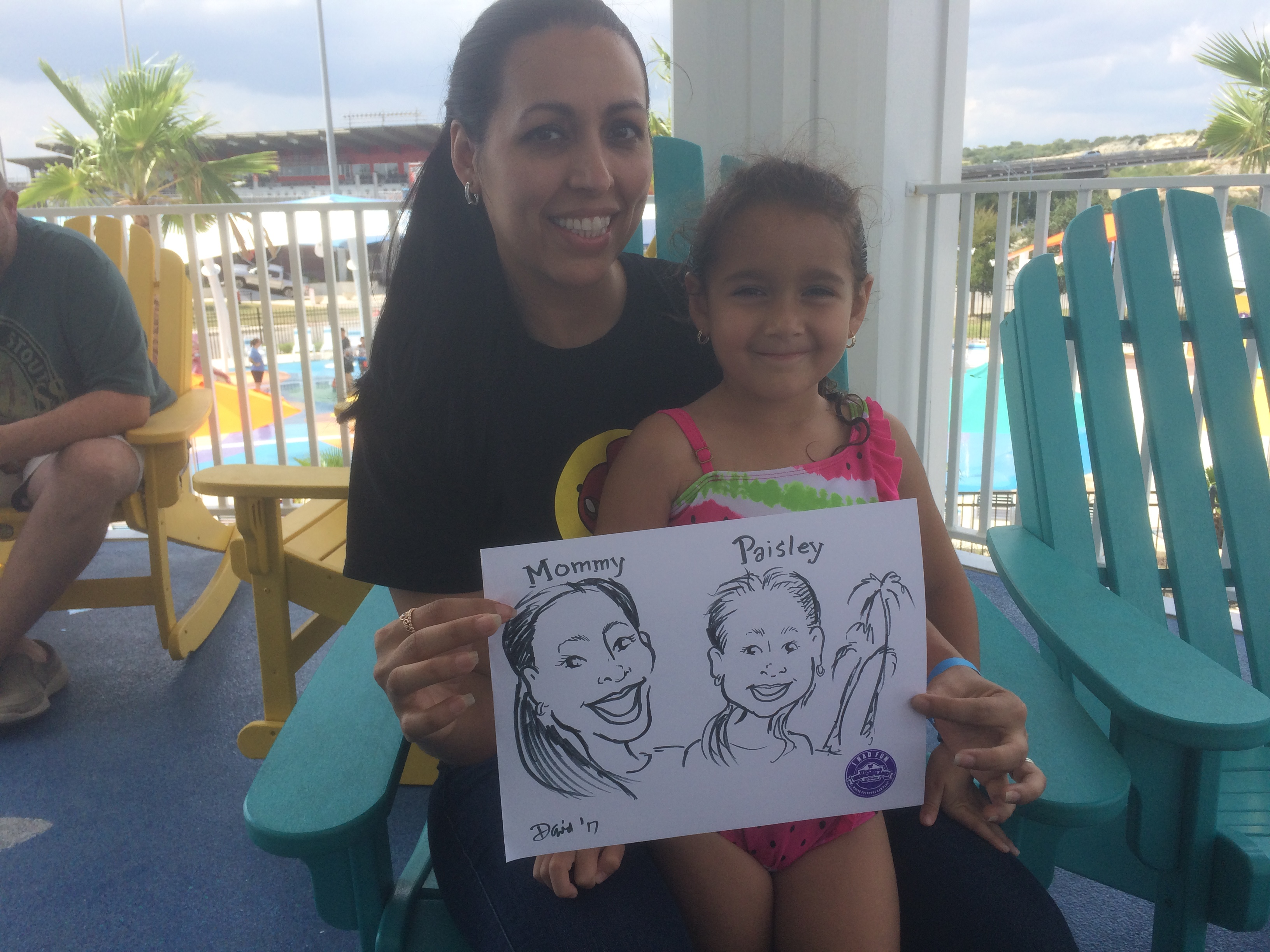 A mom and daughter enjoy a fun cartoon caricature by cartoonist David Pitts